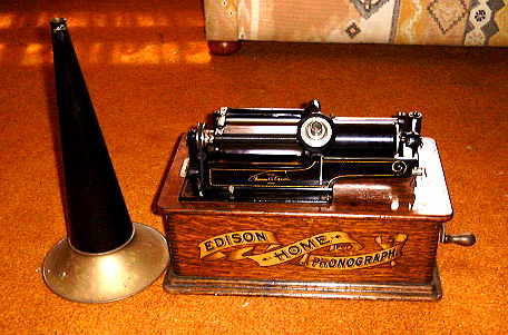 Edison Home phonograph with horn sitting at side.